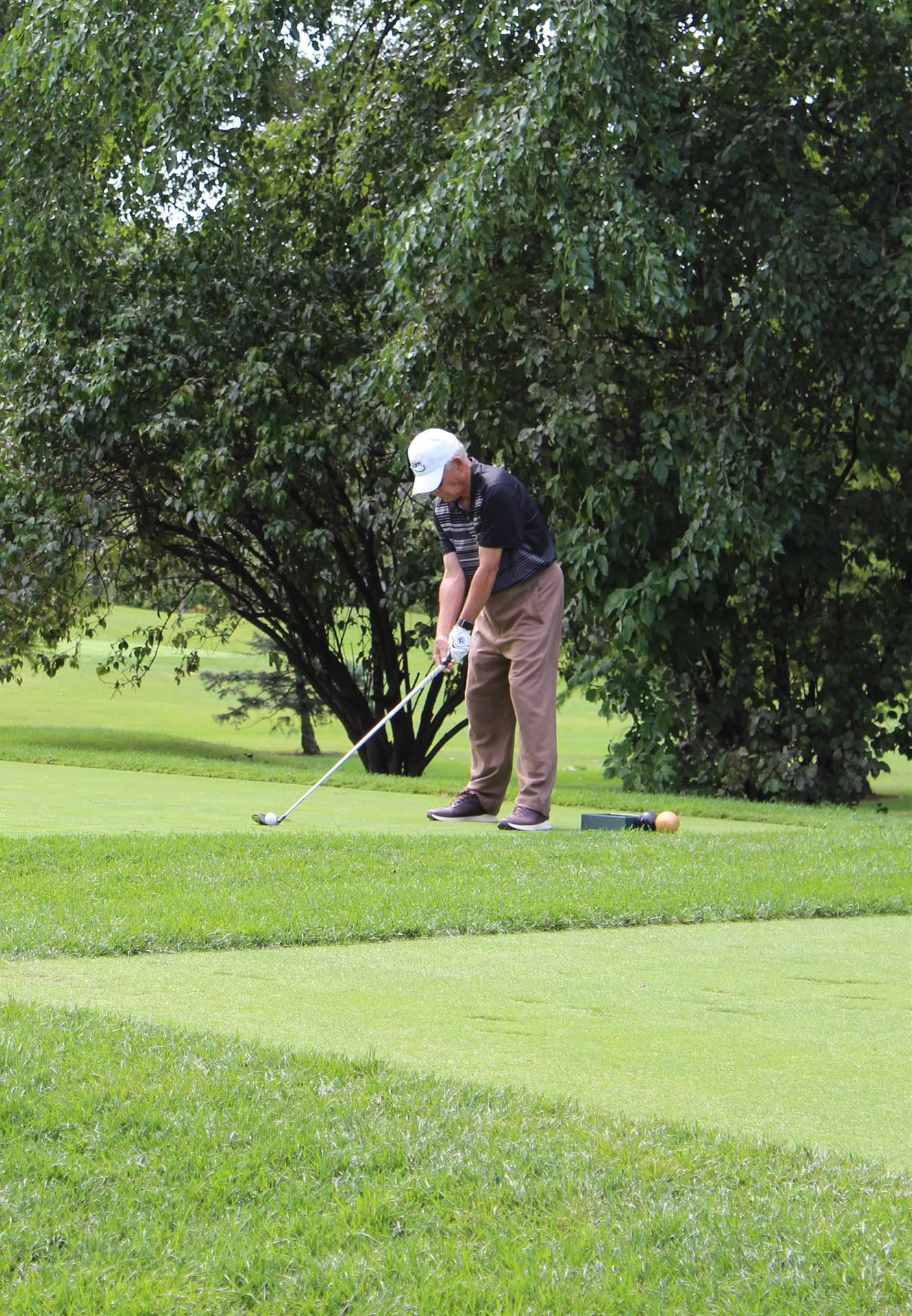Golfer-at-Tee